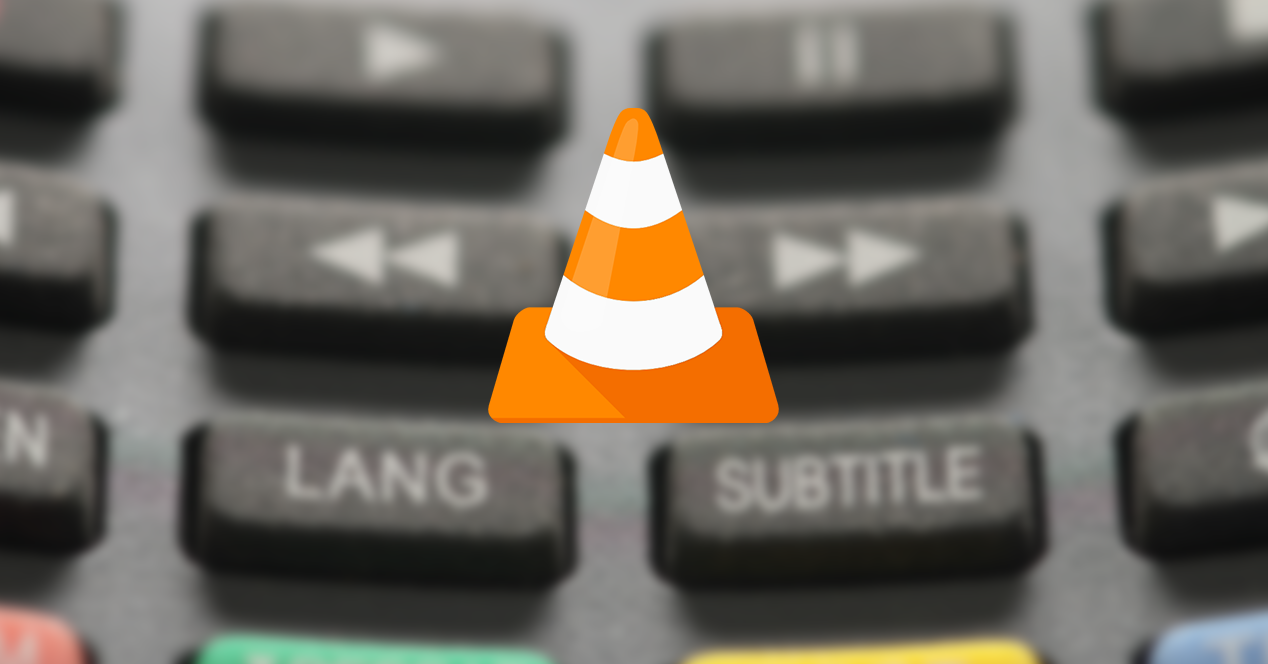 Teclas de un mando a distancia con el logo de VLC superpuesto